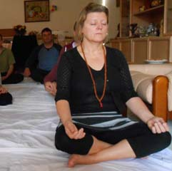 In Melbourne a Kriya Yoga student practices meditation under guidance from Swamijee